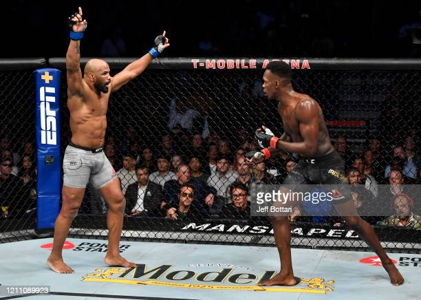 Yoel Romero of Cuba taunts Israel Adesanya of Nigeria in their UFC middleweight championship fight during the UFC 248 event at TMobile Arena on March...