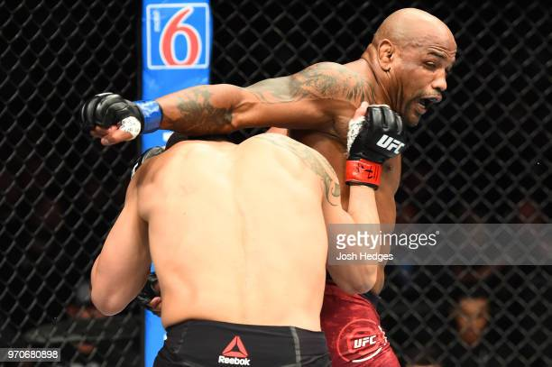 Yoel Romero of Cuba throws a spinning back fist against Robert Whittaker of New Zealand in their middleweight fight during the UFC 225 event at the...