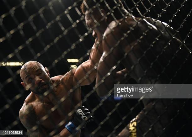 Yoel Romero punches Israel Adesanya losing to Adesanya in a decision in the middleweight title at TMobile Arena on March 07 2020 in Las Vegas Nevada