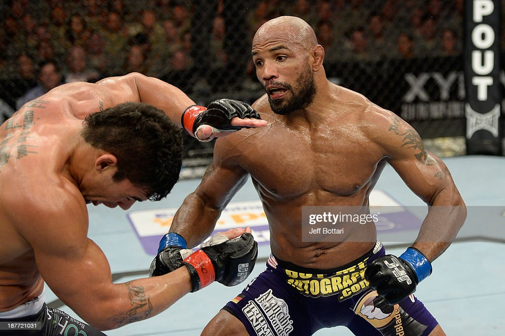 Yoel Romero punches Ronny Markes in their UFC middleweight bout on November 6, 2013 in Fort Campbell, Kentucky.
