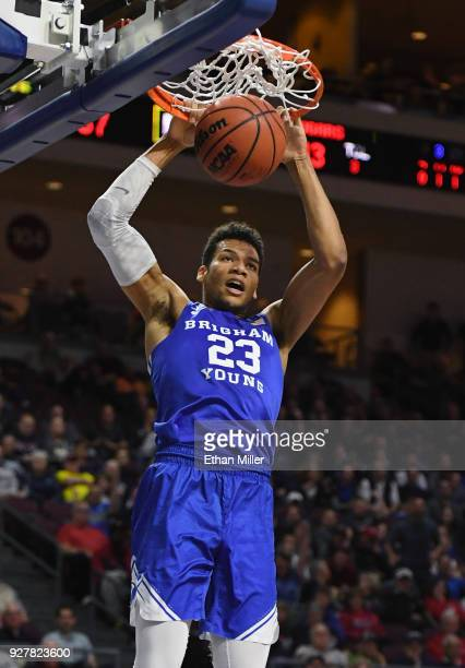 Yoeli Childs of the Brigham Young Cougars dunks against the Saint Mary's Gaels during a semifinal game of the West Coast Conference basketball...