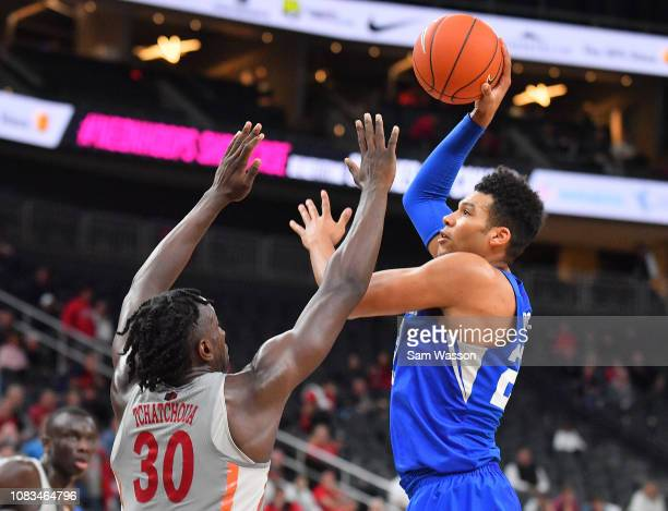 Yoeli Childs of the Brigham Young Cougars shoots against Jonathan Tchamwa Tchatchoua of the UNLV Rebels during their game at TMobile Arena on...