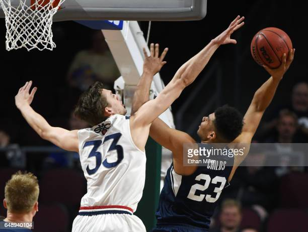 Yoeli Childs of the Brigham Young Cougars shoots against Kyle Clark of the Saint Mary's Gaels during a semifinal game of the West Coast Conference...