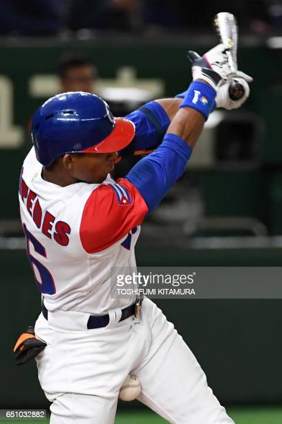 Yoelkis Cespedes of Cuba hits a foul tip in the sixth inning of the World Baseball Classic Pool B first round match between Cuba and Australia at...