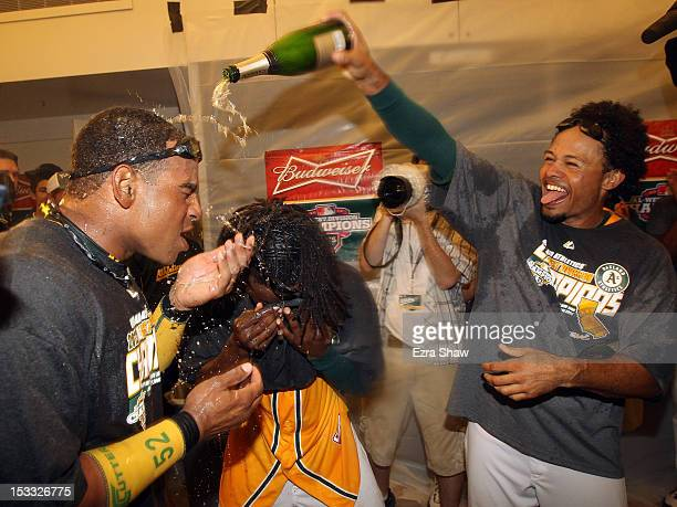 Yoenis Cespedes and Coco Crisp of the Oakland Athletics celebrate in the lockerroom after they beat the Texas Rangers at Oco Coliseum on October 3...