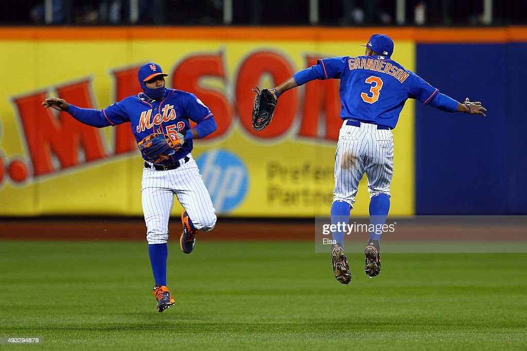 Yoenis Cespedes #52 and Curtis Granderson #3 of the New York Mets celebrate after defeating the Chicago Cubs in game two of the 2015 MLB National League Championship Series at Citi Field on October 18, 2015 in the Flushing neighborhood of the Queens borough of New York City. The Mets defeated the Cubs with a score of 4 to 1.