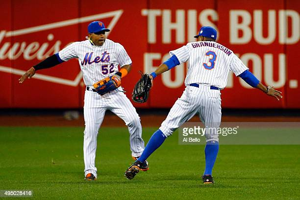 Yoenis Cespedes and Curtis Granderson of the New York Mets celebrate after defeating the Kansas City Royals by a score of 93 to win Game Three of the...
