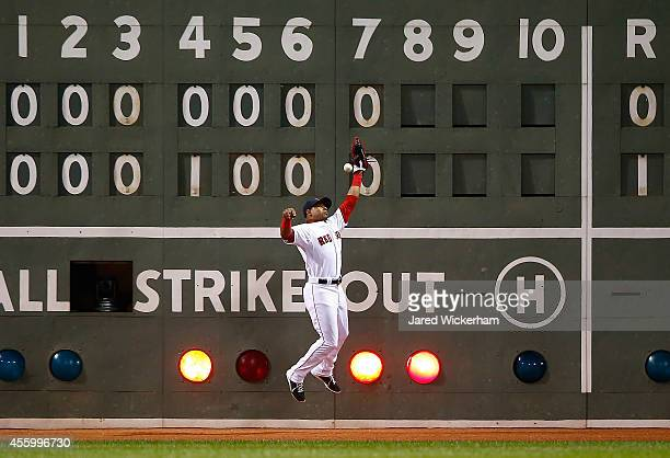 Yoenis Cespedes of the Boston Red Sox fails to make a catch in left field allowing two runs to score in the 8th inning against the Tampa Bay Rays...