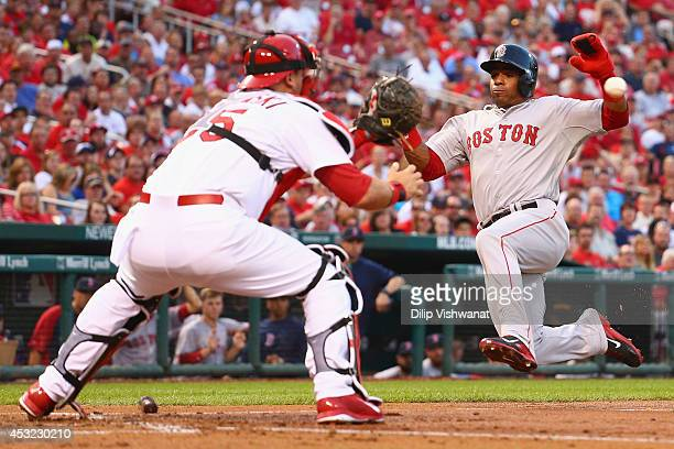 Yoenis Cespedes of the Boston Red Sox looks to score a run against AJ Pierzynski of the St Louis Cardinals in the second inning at Busch Stadium on...
