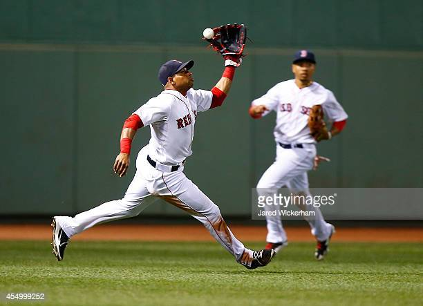 Yoenis Cespedes of the Boston Red Sox misplays a fly ball against the Baltimore Orioles during the game at Fenway Park on September 8 2014 in Boston...