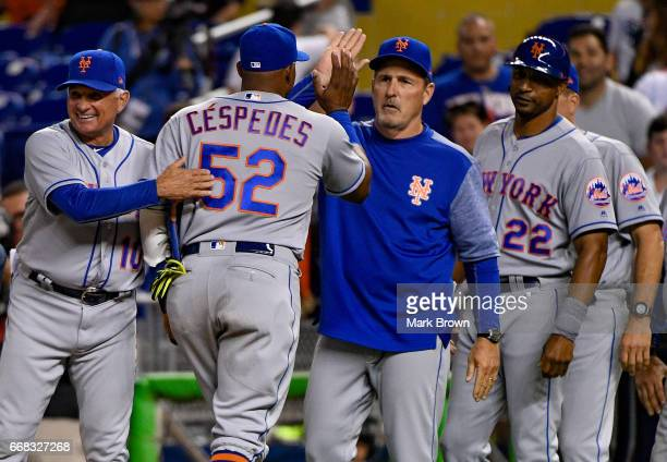 Yoenis Cespedes of the New York Mets and Terry Collins of the New York Mets high five after the game against the Miami Marlins at Marlins Park on...