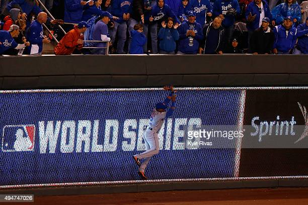 Yoenis Cespedes of the New York Mets catches a ball hit by Alex Rios of the Kansas City Royals at the wall in the sixth inning in Game Two of the...