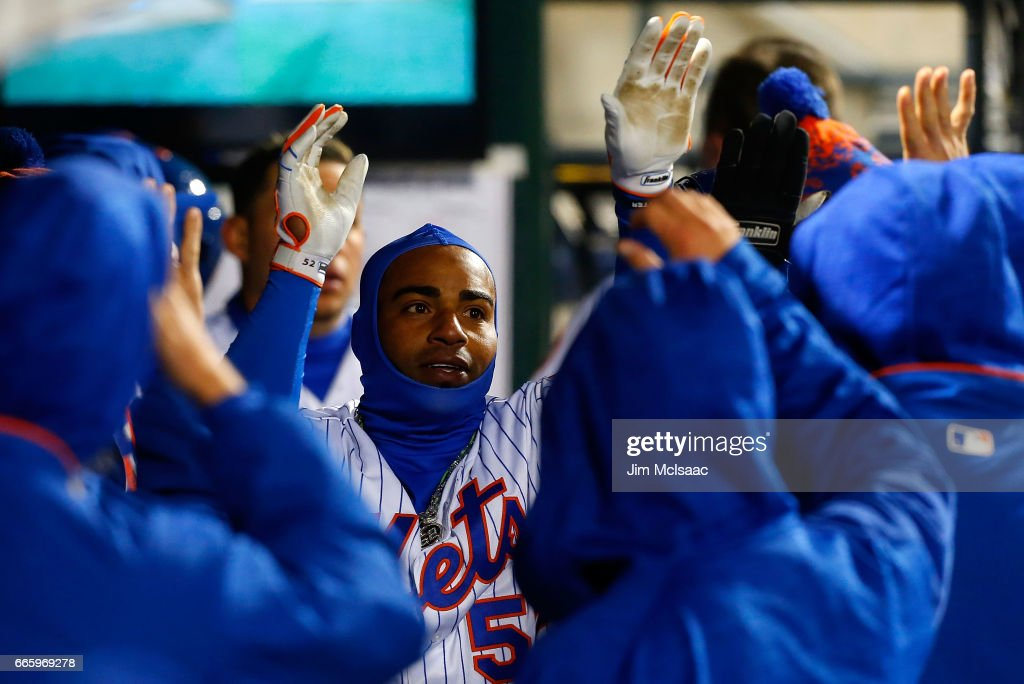Yoenis Cespedes #52 of the New York Mets celebrates his eighth inning home run against the Miami Marlins in the dugout with his teammates at Citi Field on April 7, 2017 in the Flushing neighborhood of the Queens borough of New York City.