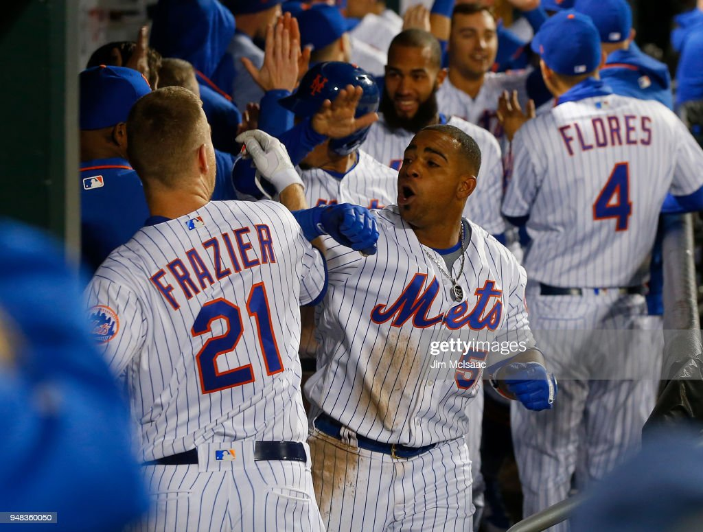 Yoenis Cespedes #52 of the New York Mets celebrates his eighth inning grand slam home run against the Washington Nationals with teammate Todd Frazier #21 at Citi Field on April 18, 2018 in the Flushing neighborhood of the Queens borough of New York City.