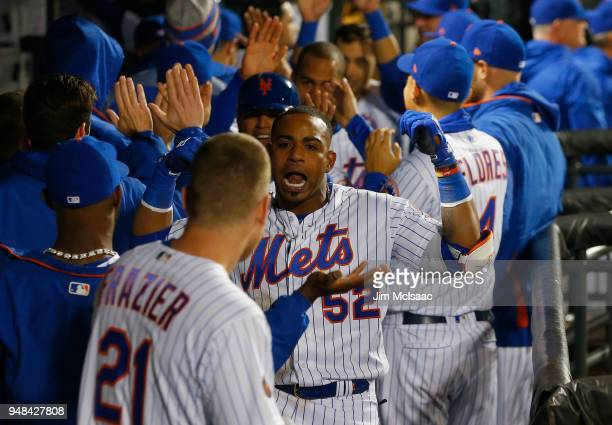 Yoenis Cespedes of the New York Mets celebrates his eighth inning grand slam home run against the Washington Nationals with teammate Todd Frazier at...