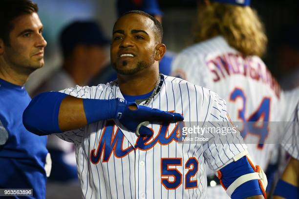 Yoenis Cespedes of the New York Mets celebrates in the dugout after hitting a solo home run in the sixth inning against the Atlanta Braves at Citi...