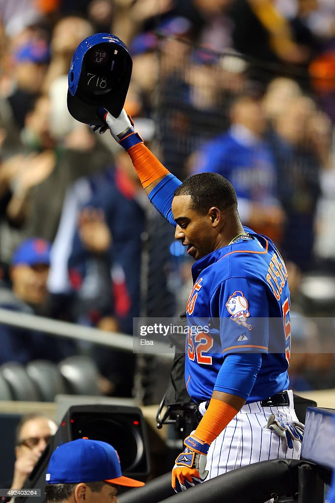 Yoenis Cespedes #52 of the New York Mets celebrates with a curtain call after hitting a three run home run against Alex Wood #57 of the Los Angeles Dodgers in the fourth inning during game three of the National League Division Series at Citi Field on October 12, 2015 in New York City.