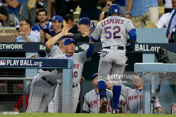 Yoenis Cespedes of the New York Mets celebrates with manager Terry Collins after hitting a solo home run in the second inning against the Los Angeles...