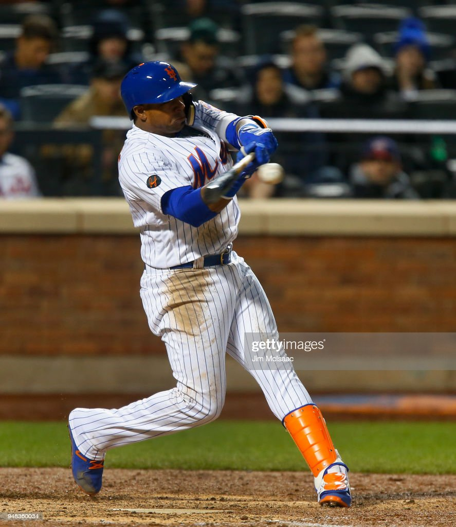 Yoenis Cespedes #52 of the New York Mets connects on an eighth inning grand slam home run against the Washington Nationals at Citi Field on April 18, 2018 in the Flushing neighborhood of the Queens borough of New York City.