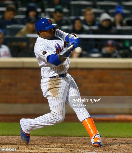 Yoenis Cespedes of the New York Mets connects on an eighth inning grand slam home run against the Washington Nationals at Citi Field on April 18 2018...