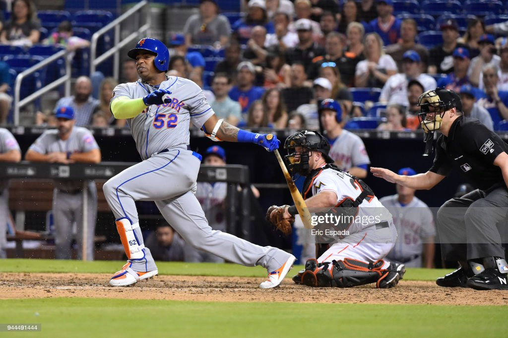 Yoenis Cespedes #52 of the New York Mets doubles in the ninth inning against the Miami Marlins at Marlins Park on April 10, 2018 in Miami, Florida.