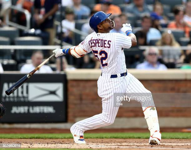 Yoenis Cespedes of the New York Mets hits a double in the first inning against the Atlanta Braves on May 2, 2018 at Citi Field in the Flushing...