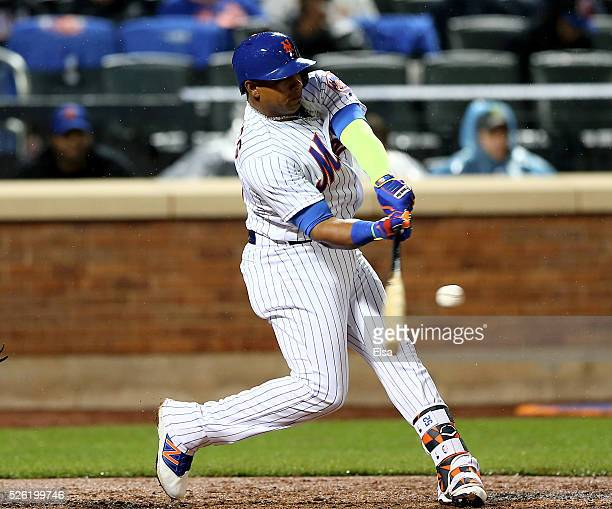 Yoenis Cespedes of the New York Mets hits a grand slam in the third inning against the San Francisco Giants at Citi Field on April 29 2016 in the...