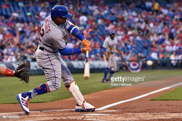 Yoenis Cespedes of the New York Mets hits a three run home run in the first inning against the Philadelphia Phillies at Citizens Bank Park on April...