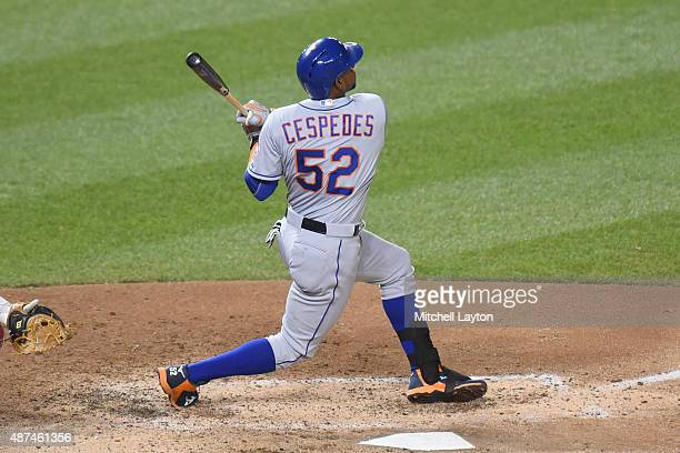 Yoenis Cespedes of the New York Mets hits a two run home run in the eight inning during a baseball game against the Washington Nationals at Nationals...