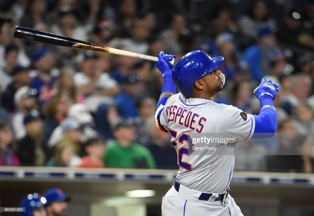 Yoenis Cespedes #52 of the New York Mets hits a two-run home run during the sixth inning of a baseball game against the San Diego Padres at PETCO Park on April 28, 2018 in San Diego, California.