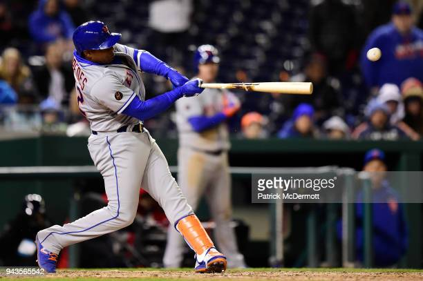 Yoenis Cespedes of the New York Mets hits an RBI single scoring Juan Lagares in the twelfth inning against the Washington Nationals at Nationals Park...
