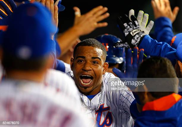 Yoenis Cespedes of the New York Mets is congratulated after he hit a game tying three run home run against the Cincinnati Reds in the seventh inning...