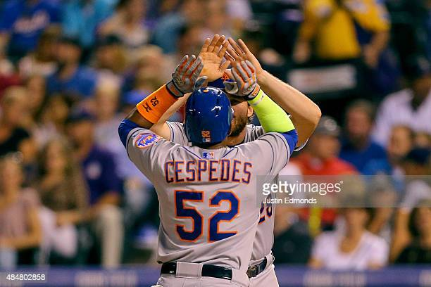 Yoenis Cespedes of the New York Mets is congratulated by Daniel Murphy after hitting his third home run of the game a three run shot during the sixth...