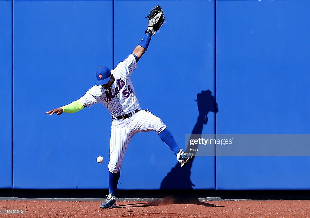 Yoenis Cespedes #52 of the New York Mets is unable to make the catch on a hit by Dustin Ackley of the New York Yankees during interleague play on September 19, 2015 at Citi Field in the Flushing neighborhood of the Queens borough of New York City.