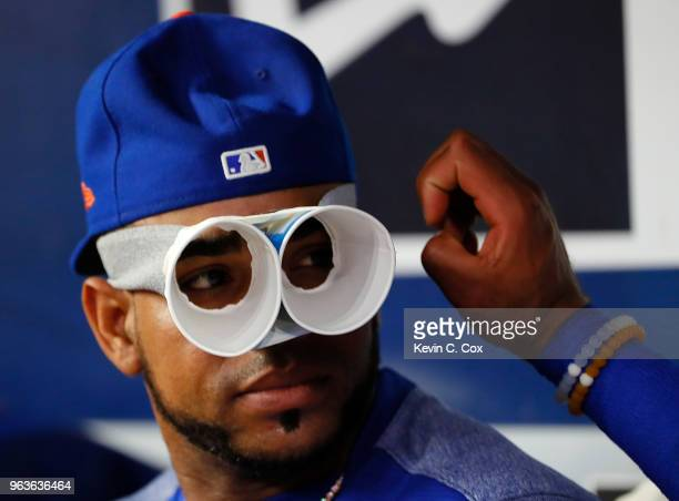 Yoenis Cespedes of the New York Mets jokes around in the dugout during the third inning against the Atlanta Braves at SunTrust Park on May 29 2018 in...