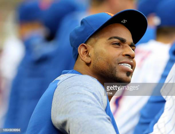 Yoenis Cespedes of the New York Mets looks on from the dugout in the first inning against the San Diego Padres on July 24, 2018 at Citi Field in the...