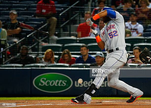 Yoenis Cespedes of the New York Mets loses his bat as he grounds out softly against the Atlanta Braves in the first inning at Turner Field on...