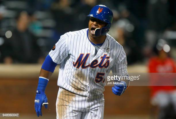 Yoenis Cespedes of the New York Mets reacts after his eighth inning grand slam home run against the Washington Nationals at Citi Field on April 18...