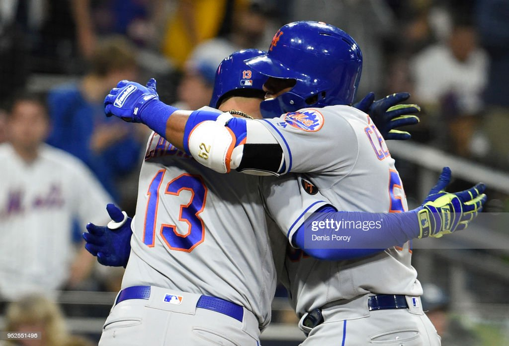 Yoenis Cespedes #52 of the New York Mets, right, is congratulated by Asdrubal Cabrera #13 after hitting a two-run home run during the sixth inning of a baseball game against the San Diego Padres at PETCO Park on April 28, 2018 in San Diego, California.