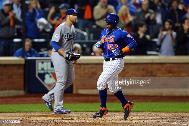 Yoenis Cespedes of the New York Mets scores off of Travis d'Arnaud single to center field in the second inning against Brett Anderson of the Los...