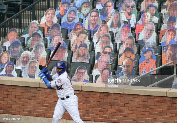 Yoenis Cespedes of the New York Mets stands in the on deck circle in front of cardboard fans during their Pre Season game at Citi Field on July 18...