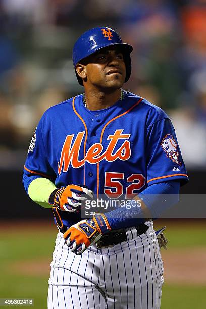 Yoenis Cespedes of the New York Mets walks off the field after flying out in the sixth inning against the Kansas City Royals during Game Five of the...