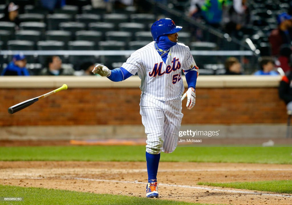 Yoenis Cespedes #52 of the New York Mets watches the flight of his eighth inning home run against the Miami Marlins at Citi Field on April 7, 2017 in the Flushing neighborhood of the Queens borough of New York City.