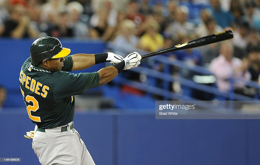 Yoenis Cespedes #52 of the Oakland Athletics bats during MLB game action against the Toronto Blue Jays July 24, 2012 at Rogers Centre in Toronto, Ontario, Canada.