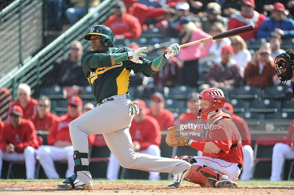 Yoenis Cespedes #52 of the Oakland Athletics bats during the game against the Los Angeles Angeles of Anaheim on Sunday, February 24, 2013 at Tempe Diablo Stadium in Tempe, Arizona. The Athletics defeated the Angels 7-5.