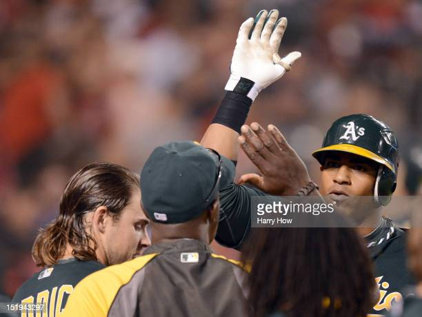 Yoenis Cespedes of the Oakland Athletics celebrates his solo homerun for a 2-0 lead over the Los Angeles Angels during the sixth inning at Angel...