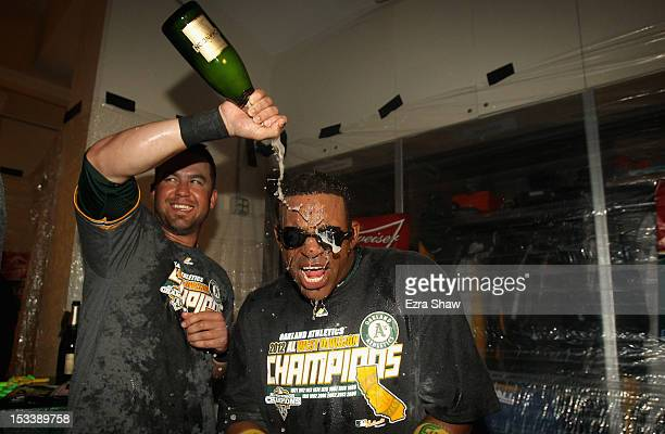 Yoenis Cespedes of the Oakland Athletics celebrates in the locker room after they beat the Texas Rangers to win the American League West Division...