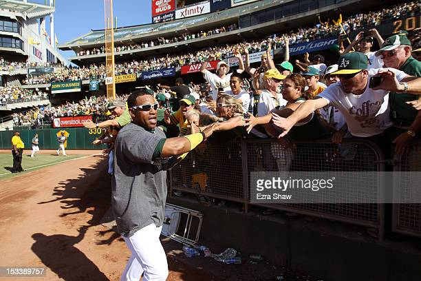 Yoenis Cespedes of the Oakland Athletics celebrates with the fans after they beat the Texas Rangers to win the American League West Division Title at...