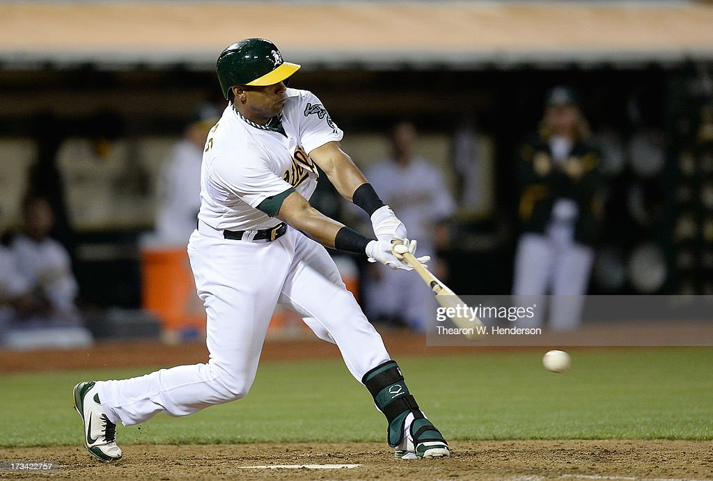 Yoenis Cespedes #52 of the Oakland Athletics hits a single in the eighth inning against the Boston Red Sox at O.co Coliseum on July 13, 2013 in Oakland, California.
