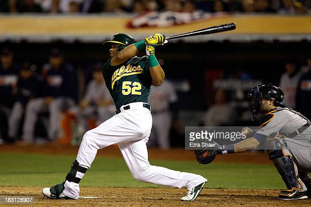 Yoenis Cespedes of the Oakland Athletics hits two run home run in the seventh inning against Max Scherzer of the Detroit Tigers during Game One of...